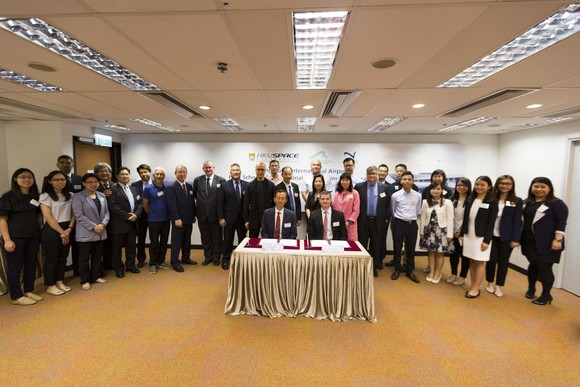 Staff members group photo of the MOU signing ceremony